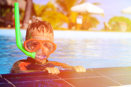 little boy swimming: little boy swimming with mask in outdoor pool Stock Photo