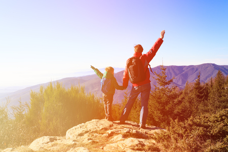 happy family hiking in scenic mountains, family travel Stock Photo