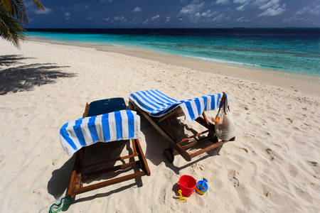 two chairs: Two chairs on the tropical beach vacation
