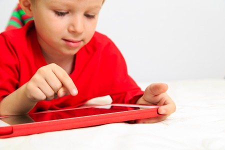 Little boy with touch pad, early education and modern technology Stock Photo
