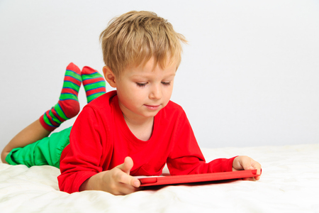 early education: Little boy with touch pad, early education and modern technology Stock Photo