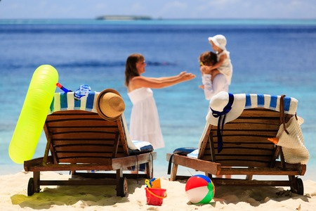 chairs on tropical beach, family beach vacation concept