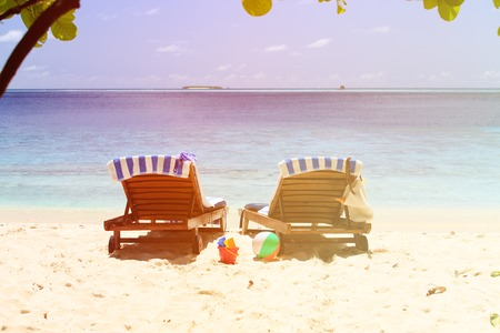 two chairs: Two chairs on the tropical beach, family vacation