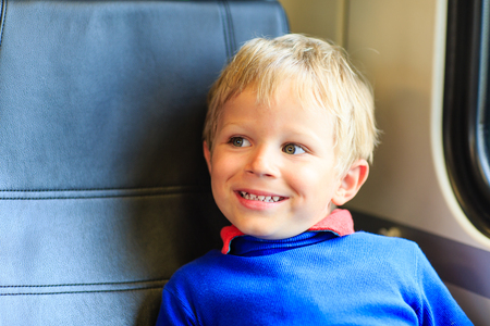 u bahn: happy little boy travel by train, kids travel