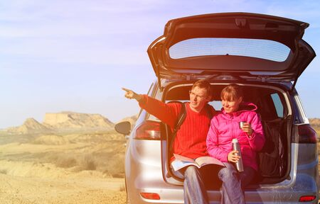 winter vacation: happy couple travel by car in scenic mountains, family travel Stock Photo