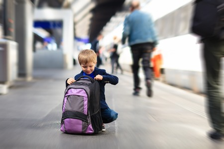 u bahn: little boy travel by train waiting on tube platform, kids travel