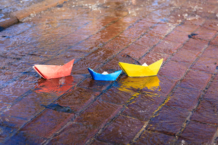 tar paper: paper boats in spring water puddle, spring kids activities