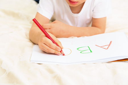 early education: little boy learning to write letters, early education Stock Photo