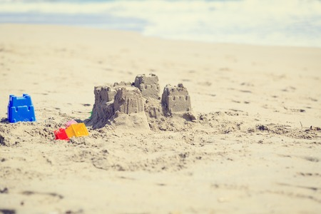 children sandcastle: Sand castle on the beach, family vacation