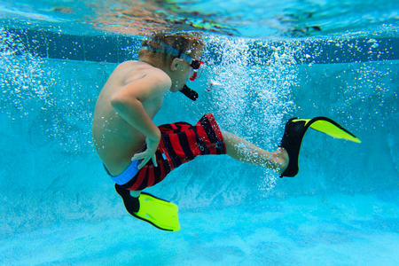 flippers: little boy swimming underwater with mask and flippers, active kids