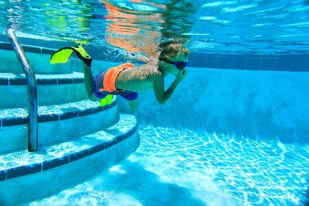 little boy swimming: little boy swimming underwater, active kids sport