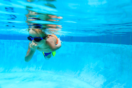 learns: little boy learns swimming underwater, active kids Stock Photo