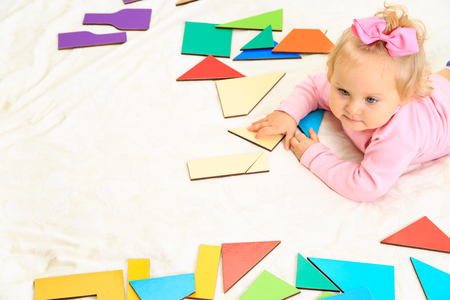 early education: cute little girl playing with puzzle, early education