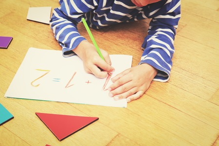 early education: little boy writing numbers, early education concept Stock Photo