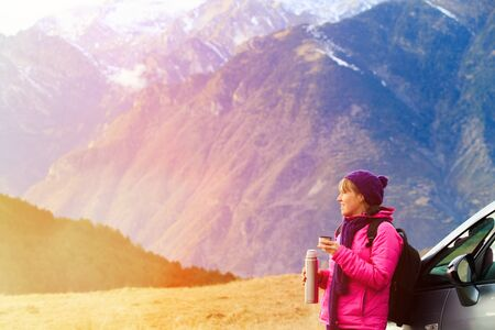 young woman travel in winter mountains, tourism concept
