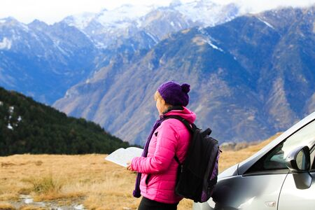 concept car: young woman travel in winter mountains, tourism concept