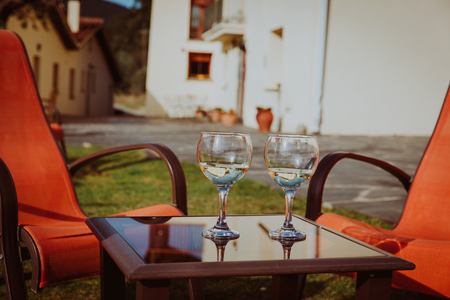 out of town: two glasses of wine in countryside, relax out of town concept