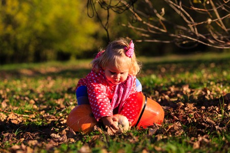 trick or treating: little girl trick or treating in autumn nature Stock Photo