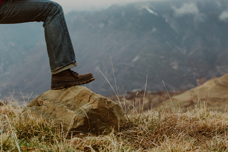 ifestyle: hiking boots in scenic mountains, travel concept Stock Photo