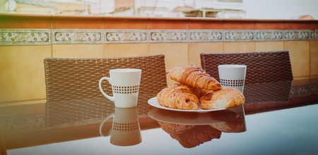 Coffee with croissants served in european city cafe Stock Photo