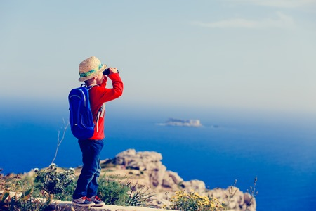 little boy with binoculars hiking in mountains, kids travel