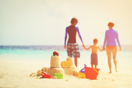 sand castle on tropical beach, family beach vacation