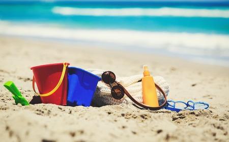 suncream: bag, suncream, kids toys on the beach, family vacation