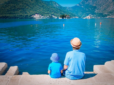 travel concept - father and son looking at scenic view in Montenegro Stock Photo