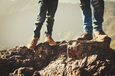 father and son hiking boots in mountains Stock Photo