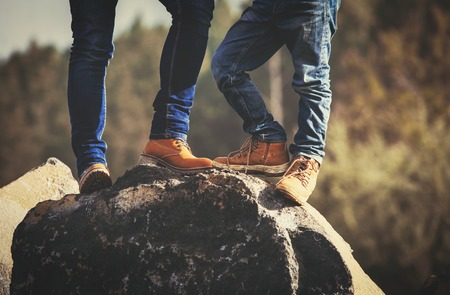mother and son hiking boots in mountains