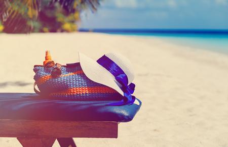 suncream: Beach vacation concept - bag, sun glasses and suncream at sea