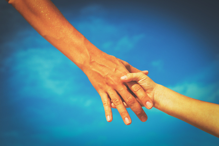 helping hand of mother and child on sky Stock Photo