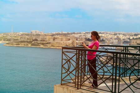 tourist making photo of Valetta, Malta, travel concept