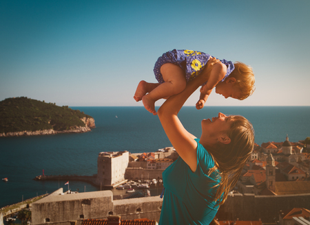 happy mother and little daughter enjoy vacation in Europe