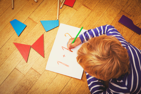 little boy learning numbers and shapes, education Reklamní fotografie
