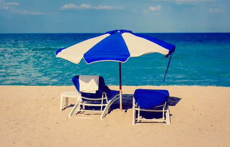 Two chairs on sand beach Stock Photo