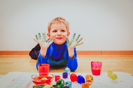 little boy painting eggs for easter Stock Photo