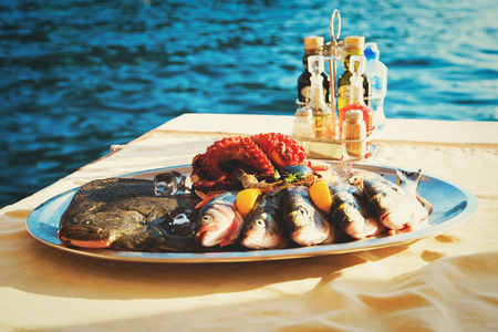 fresh seafood plate in restaurant at sea
