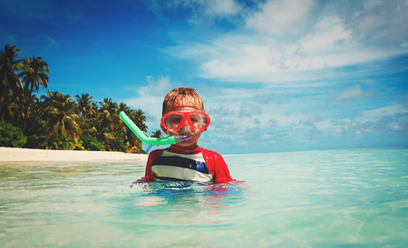 little boy swimming with mask at sea Stock Photo