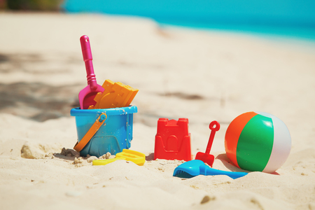 kids toys on tropical sand beach Stock Photo - 78011570