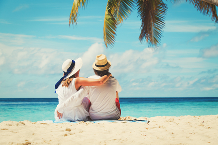 sunhat: happy loving couple on tropical beach Stock Photo