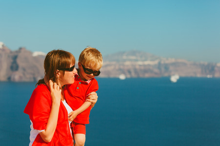 happy mother and son travel in Santorini, Greece