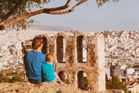father and son looking at Odeon in Acropolis, Athens, Greece