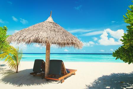 Beach chairs on the tropical beach Stock Photo