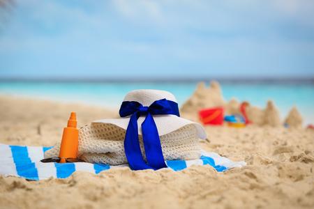 bag, suncream, glasses on beach Stock Photo