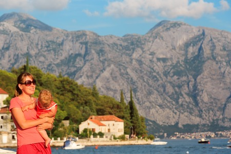 mother with little daughter on vacation in Montenegro