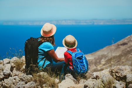 mother and son hiking in mountains Stock Photo