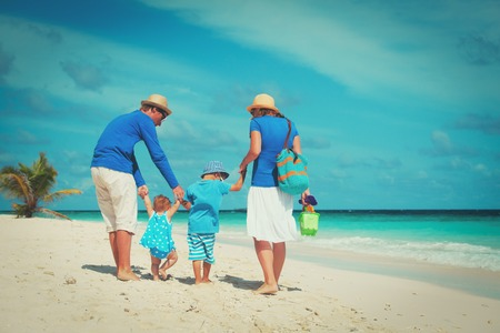 family with little son and daughter walk on beach Stock Photo