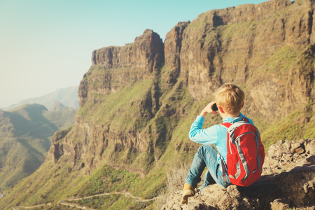 little boy hiking in mountains