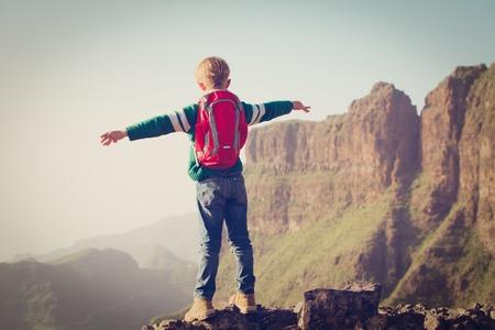little boy hiking on top of mountains 版權商用圖片